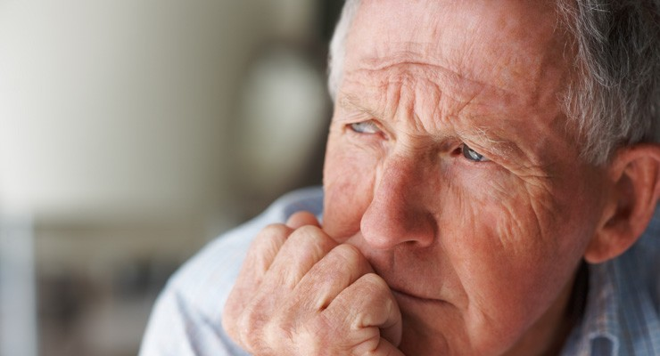 older man with chin in hand, thinking