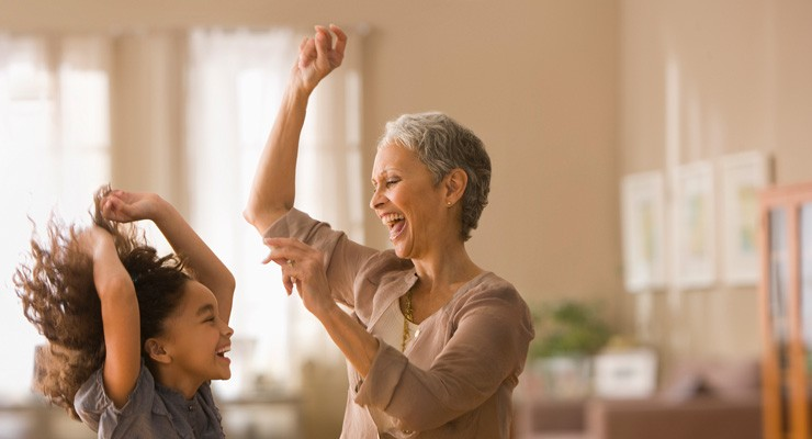 grandmother dancing with granddaughter